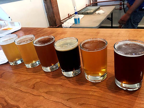 a flight of beers at Powers Farm and Brewery